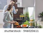 happy man feeding food to woman ... | Shutterstock . vector #546020611