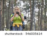 female hiker photographing... | Shutterstock . vector #546035614
