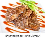Roasted lamb meat tied with scallion closeup - stock photo