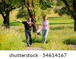 family having a walk outdoors... | Shutterstock . vector #54614167