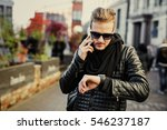 man in the city talking on the... | Shutterstock . vector #546237187