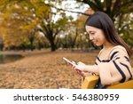 woman using cellphone at park | Shutterstock . vector #546380959