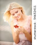 Beautiful Girl Reads Sms On...
