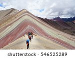 Rainbow Mountain With Hiker At...