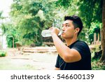 handsome young man drinking... | Shutterstock . vector #546600139