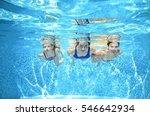 family swims in pool under... | Shutterstock . vector #546642934