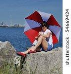 Lady with umbrella against Toronto SKyline - stock photo