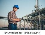 man using tablet at natural gas ... | Shutterstock . vector #546698344
