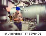 man wearing blue hardhat using... | Shutterstock . vector #546698401