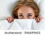 beautiful blonde woman hiding... | Shutterstock . vector #546699601