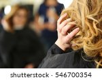 Small photo of Blonde woman at hairdresser checking and fixing her new curly hairdo with hand. Keratin restoration, latest trend, fresh idea, haircut picking, shorten tips, instrument store concept