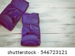 pair of blue boxing gloves on a ... | Shutterstock . vector #546723121