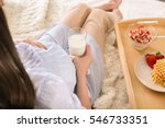 pregnant woman with glass of... | Shutterstock . vector #546733351