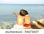 Two little friends on the shore - stock photo