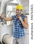 happy young male worker... | Shutterstock . vector #546761821