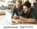 Young Couple In New Flat Using...