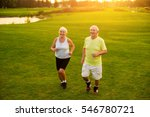 elderly couple jogging. smiling ... | Shutterstock . vector #546780721
