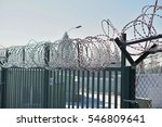 high metal fence with a sharp... | Shutterstock . vector #546809641