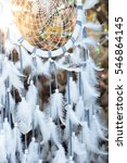 Small photo of a Native american dream catcher moved by wind