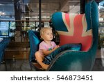 little girl sitting in the big... | Shutterstock . vector #546873451