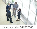 businessmen and woman standing