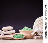 Small photo of Spa salt, stones, towel, wisp, flower branch for beauty and health. Healthy relaxation, therapy and treatment. Aromatherapy, body care, aroma massage. Alternative lifestyle