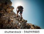 hiker crossing rocky terrain at ... | Shutterstock . vector #546949885
