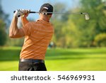 young man swinging golf club ... | Shutterstock . vector #546969931