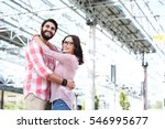 happy couple looking away while ... | Shutterstock . vector #546995677