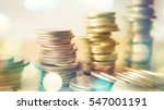 rows of coins and blurred bokeh ... | Shutterstock . vector #547001191