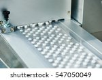 tablet pill production | Shutterstock . vector #547050049