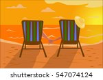 Man And Woman Sit In Beach...
