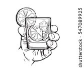 hand holding glass of gin ...   Shutterstock .eps vector #547089925