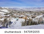 A Chair Lift Brings Skiers To...