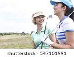 cheerful female friends at golf ... | Shutterstock . vector #547101991