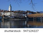Olten, Solothurn, Switzerland - December 29, 2016: View of Olten old city and wooden foot bridge across the Aare River on sunny winter day