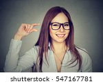 woman showing small amount size ... | Shutterstock . vector #547167781