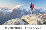 tourist on the peak of high... | Shutterstock . vector #547277224