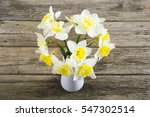 white daffodils at china vase... | Shutterstock . vector #547302514