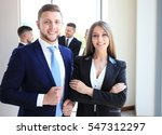 group of business people at a... | Shutterstock . vector #547312297