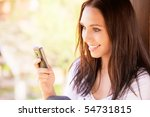 Lovely Young Woman Reads Sms O...