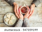 Tea Lovers ' Hands. On Wooden...