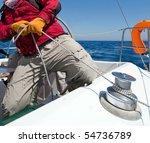 Man holding rope on sailing boat - stock photo