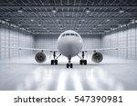 3d rendering airplane in hangar | Shutterstock . vector #547390981