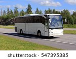 New White Coach Bus Moves Alon...