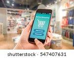 online shopping.hands holding... | Shutterstock . vector #547407631
