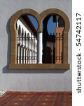 arched window with grate to the ... | Shutterstock . vector #54742117