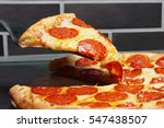 slice of pizza pepperoni on... | Shutterstock . vector #547438507