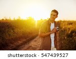 handsome happy young traveler... | Shutterstock . vector #547439527