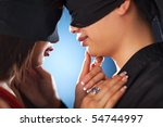 Young japan couple with bandage on eyes in love. - stock photo